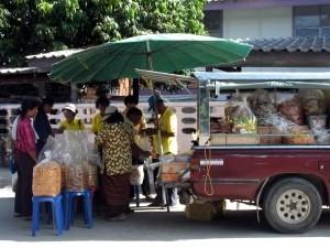 """Thai tourists buying """"khong fak""""."""