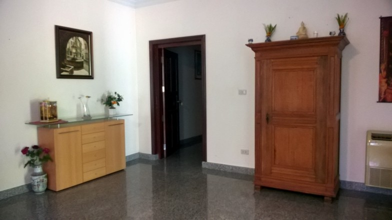 The house is partially furnished. The doors are made of teak wood.