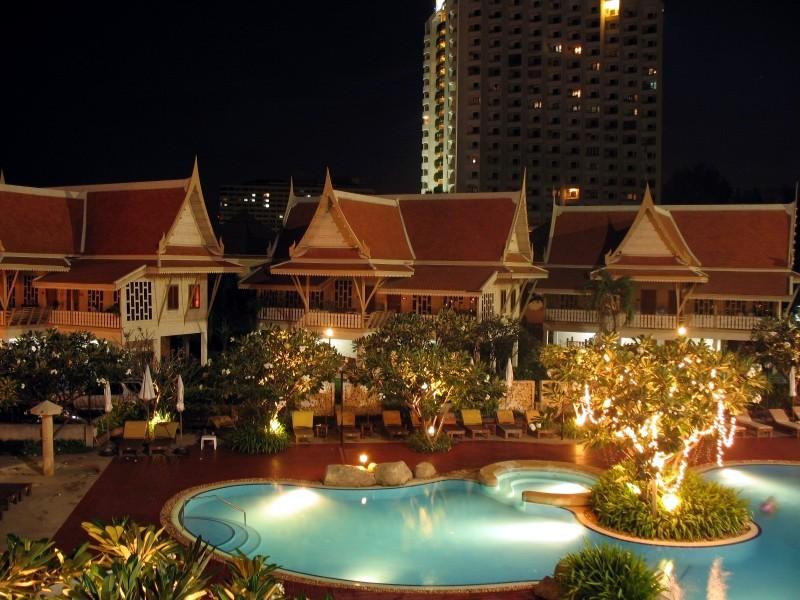 The villas at night.